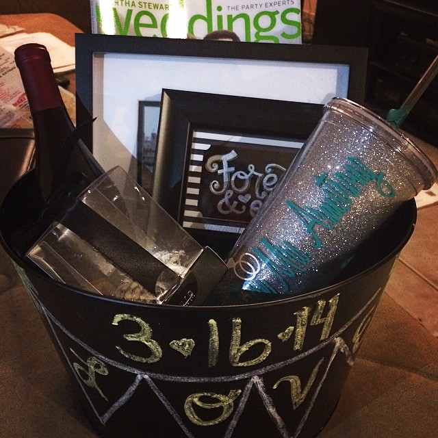"I have the most amazing friends!! @kristikupcakes just dropped by with this amazing engagement gift basket! I could have cried ️ It has ring cleaner, a ring holder, two pretty frames, a bottle of wine, a bridal magazine and a sparkly tumbler that she had made custom that says ""Future Mrs Armstrong""  Thank you so much Kristi you are amazing and so thoughtful ️"