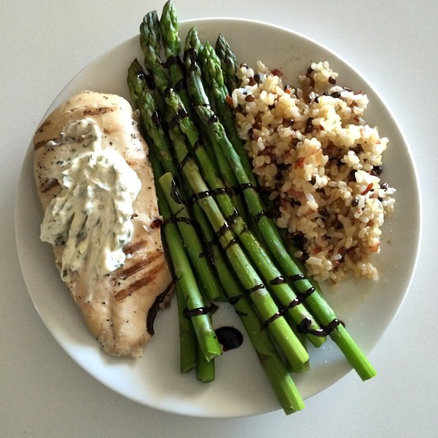 "Lunching so hard right now!! All this jazz is from my trip to #traderjoes (which my phone just tried to auto correct to ""trader hoes""- no comment). Pre-grilled chicken breast, steamed asparagus and frozen wild rice medly. Toppings are cilantro chive Greek yogurt dressing and balsamic glaze. This all took no more than 10 min. I haven't properly done #mealprep in awhile because I end up wasting food since I'm traveling so much. TJ's really came through with the prepackaged basics- no preservatives, just frozen whole foods and fresh veggies that require little to no prep work! #macros for this masterpiece: 35g C, 40g P, 8g F, 7g fiber#healthyfood #fasthealthyfood #contestprep #prepfriendly #macrodieting #iifym #flexibledieting #bikiniprep #npcaz #eatforabs"